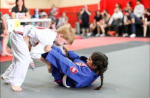 Kids doing a Brazilian jiu jitsu class