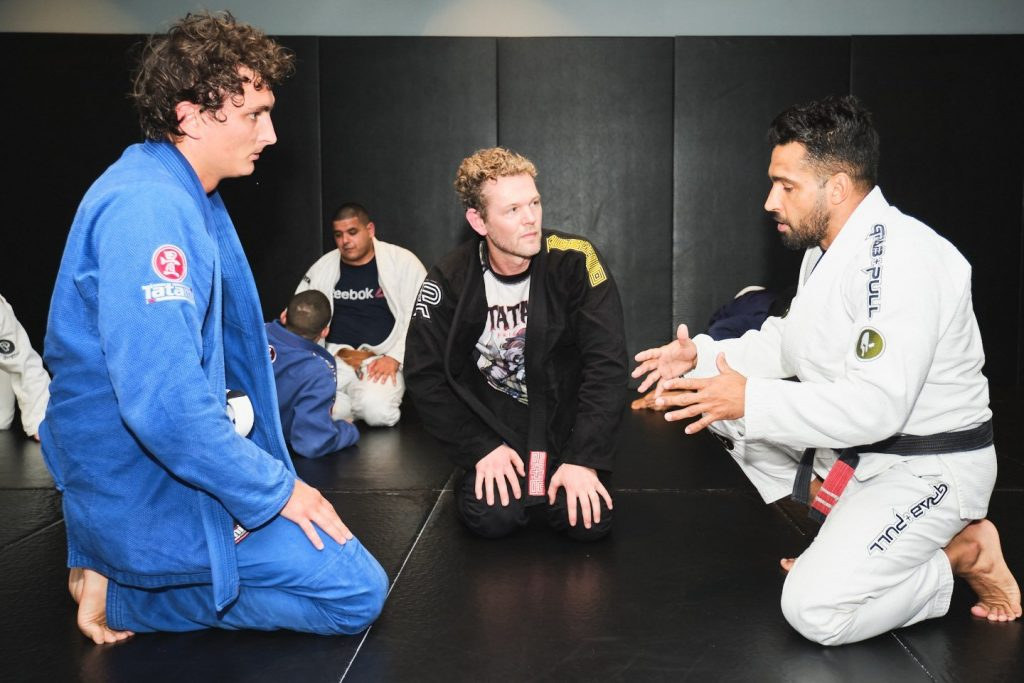 People discussing: What belt can teach BJJ?
