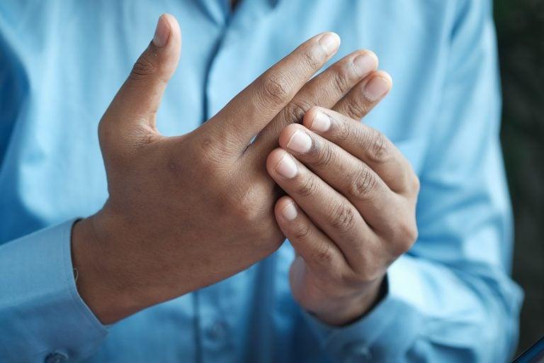 man with finger pain form BJJ